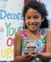 girl holiding cupcake
